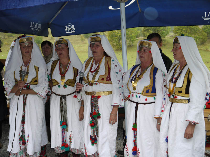The village women sing in Bosnian village.